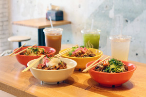 Wok Street's Signature Rice Bowls and Drinks. This weekend redeem a free beverage with a purchase